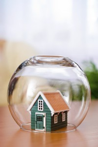 House insurance concept: covered with a glass ball to protect